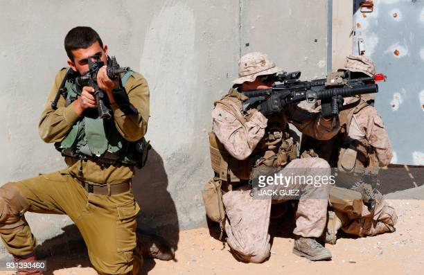 Israeli paratroopers and US army soldiers of Battalion Landing Team 2nd Battalion 6th Marine Regiment 26th Marine Expeditionary Unit take part in...