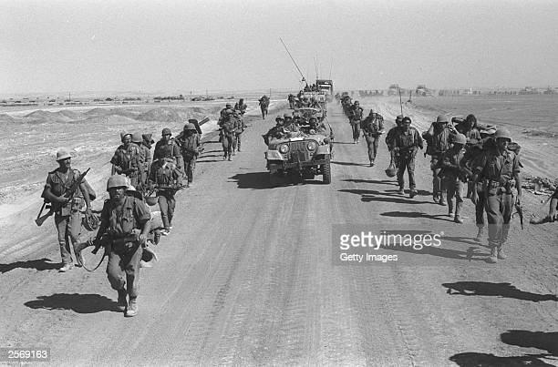 Israeli paratroopers march October 25 1973 along the SuezCairo road on the western bank of the Suez Canal during the Yom Kippur War Current Israeli...