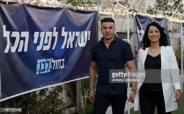 Israeli parliament member of the centrist Blue and White alliance Gadeer Mreeh , from Israel's Druze community, walks alongside her husband Shadi...
