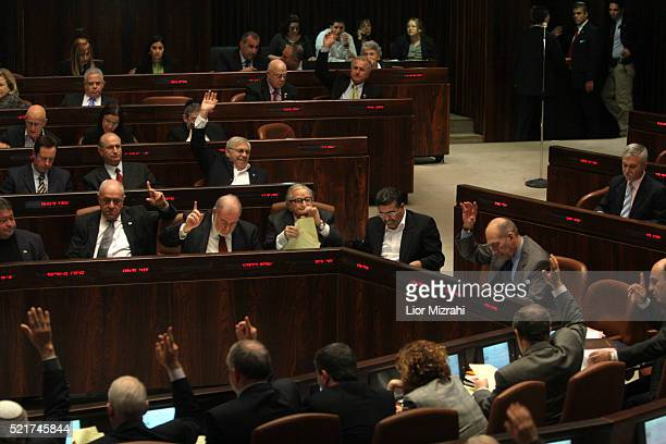 Israeli parliament members vote at the Knesset during an Economic Arrangements Law vote in Jerusalem on Wednesday January 03 2006 The Knesset plenum...