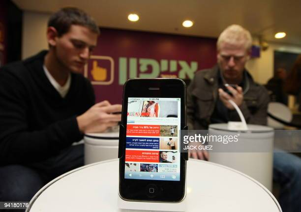 Israeli people wait to purchase the new iPhone 3Gs at an Apple store on December 9 2009 in Tel Aviv Israel Hundreds of people lined up at the Apple...