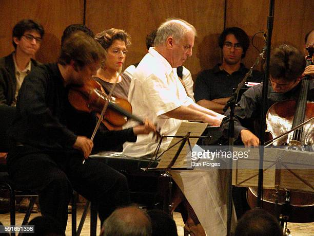 Israeli pianist Daniel Barenboim performs with violinist Rene Capucon during the 5th Jerusalem International Chamber Music Festival at the Jerusalem...