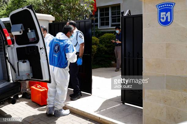 Israeli police abd forensic experts gather in front of the residence of Israel's Chinese ambassador on the outskirts of Tel Aviv, after he was found...