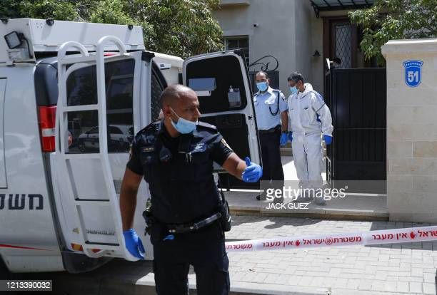 Israeli police and forensic experts gather in front of the residence of Israel's Chinese ambassador on the outskirts of Tel Aviv, after he was found...