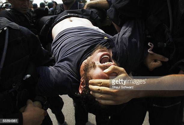 Israeli police arrest antidisengagement activists trying to prevent the entry of shipping containers August 16 2005 into Neve Dekalim the largest...