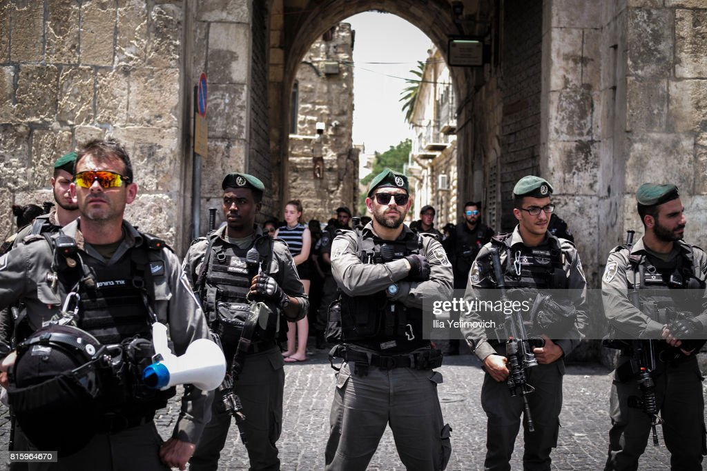 Israeli Police block the entrance to the old city of Jerusalem during a noon prayer as members of the Muslim community protest on July 17, 2017 in Jerusalem, Israel. Following Friday's terror attack the holy site of Al Aqsa mosque was partly closed. Now only individuals can enter through metal detectors which has sparked large outrage of Musil community.