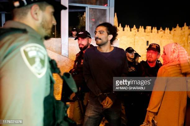 Israeli police detain a Palestinian protester during a demonstration calling for the release of Jordanian national Hiba alLabdi currently in Israeli...