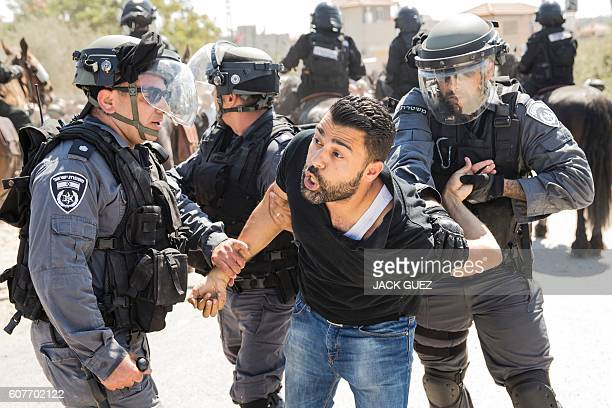 Israeli police detain an Arab-Israeli man on September 19 as residents of the northern Arab-Israeli village of Ara protest against fifty right-wing...