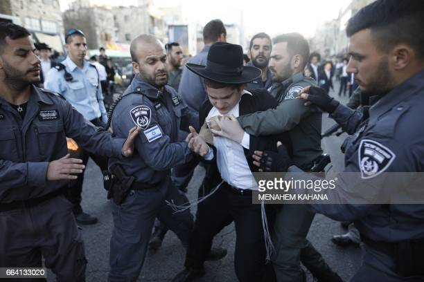 TOPSHOT Israeli police detain ultraOrthodox Jews during a protest against Israeli army conscription in the centre of Jerusalem on April 3 2017 Many...