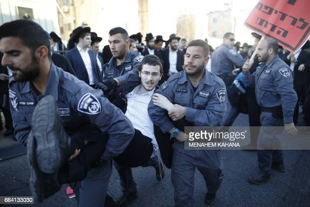 Israeli police detain ultraOrthodox Jews during a protest against Israeli army conscription in the centre of Jerusalem on April 3 2017 Many...