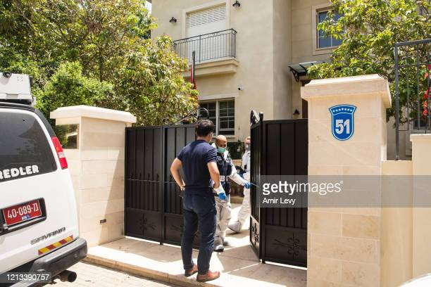 Israeli police enter the house of China's Ambassador to Israel Du Wei, after he was found dead in his house on May 17, 2020 in Herzliya, Israel. Du...