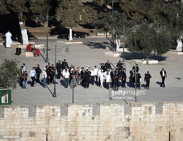 Israeli police escort a group of Jewish visitors walking at the AlAqsa mosque compound in Jerusalems old city on September 28 2015 New clashes broke...