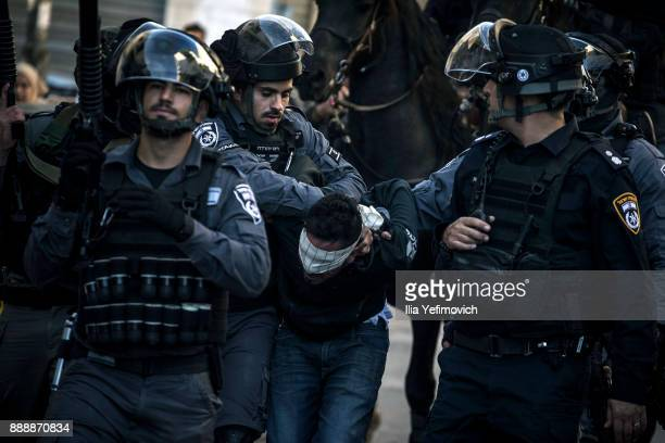 Israeli police forces arrest a Palestinian protester on December 9 2017 in Jerusalem Israel Protest in Jerusalem West Bank and Gaza continue into the...