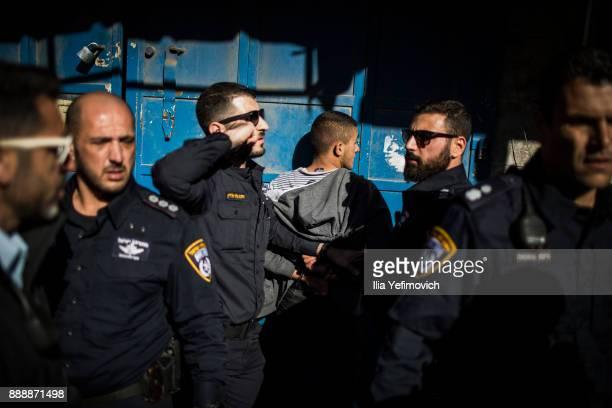 Israeli police forces arrest a Palestinian protester on December 9 2017 in Jerusalem Israel Protest in Jerusalem West Bank and Gaza continue into the...