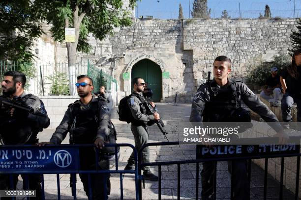 Israeli police forces stand guard the alAqsa mosque compound in the Jerusalem's Old City on July 27 after it was closed off by Israeli authorities...