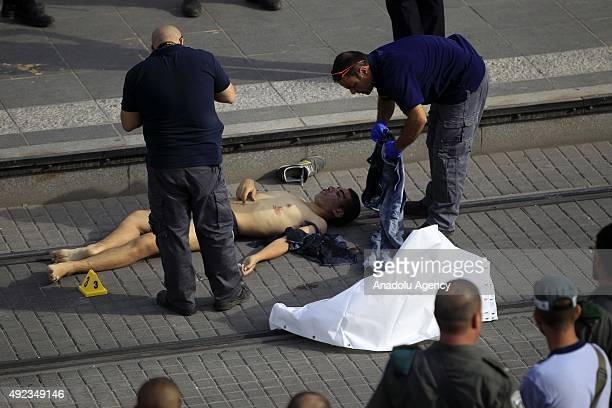Israeli police inspect the area after Israeli police shot dead a Palestinian man who allegedly stabbed two Israelis in the Pisgat Ziev residential...