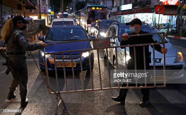 Israeli police install a barrier on the road in the religious Israeli city of Bnei Brak, near Tel Aviv, amid measures put in place by Israeli...