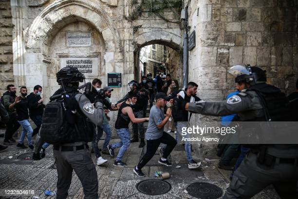 Israeli police intervene Palestinians with tear gas, rubber bullets and stun grenades near the Lion Gate of East Jerusalem on May 10, 2021.
