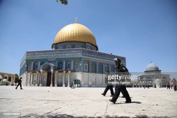 Israeli police officers are seen after they attack people with tear gas canisters and blast bombs following friday prayer during 1st anniversary of...
