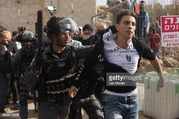 Israeli police officers arrested a Palestinian man outside the Old City on December 15 2017 in Jerusalem Israel Hundreds of Palestinians protested in...