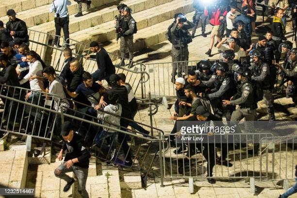 Israeli police officers clash with Palestinans at Damascus gate in Jerusalem's old city during the holy Muslim month of Ramadan on April 24, 2021 in...