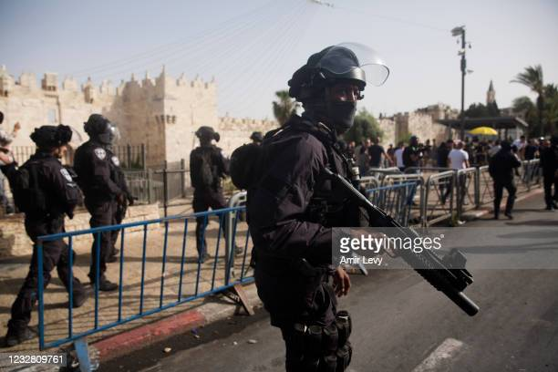 Israeli Police officers clash with Palestinians at Damascus Gate in Jerusalem's old city during Israel's 'Jerusalem Day' on May 10, 2021 in...