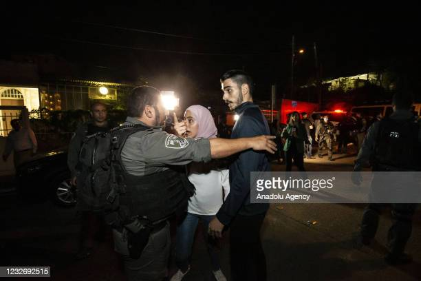 Israeli police officers intervene in Palestinians during a demonstration at Sheikh Jarrah neighborhood after Israeli government's plan to force some...