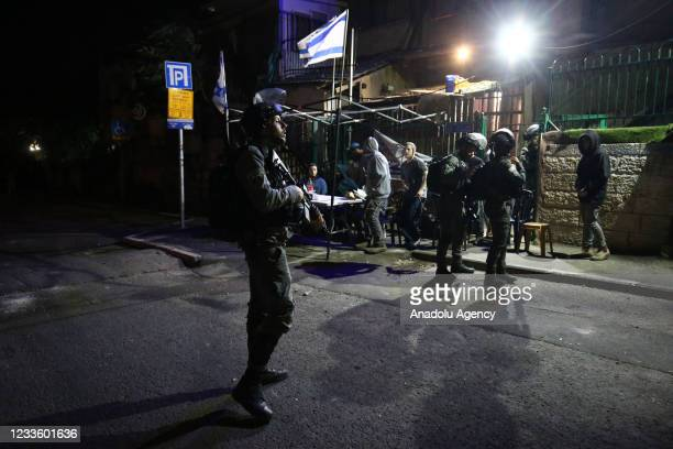 Israeli police officers intervene Palestinians with sound bombs and tear gas canisters after clashes erupted between Palestinians and Jewish settlers...