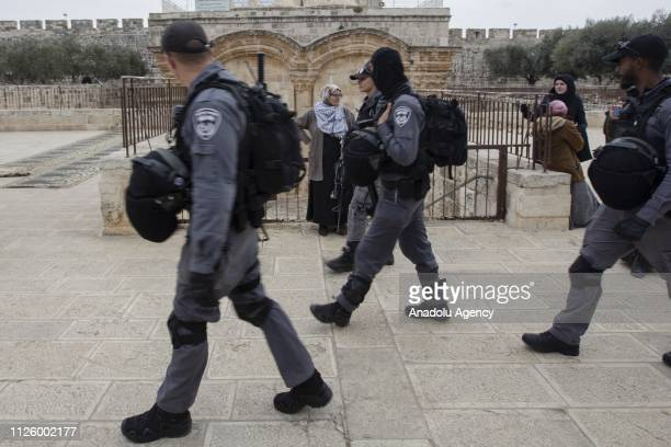 Israeli police officers patrol at AlAqsa Mosque Compound as Palestinians perform prayer in front of AlRahma Gate of AlAqsa Mosque Compound after it...