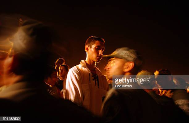 Israeli police officers scuffle with a Gush Katif resident in opposition of Ariel Sharon's scheduled pullout plan on Sunday July 17 2005 near the...
