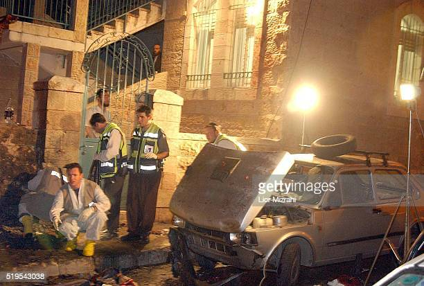 Israeli Police officers search the scene after a suicide bombing in Jerusalem Saturday March 02 2002. Nine people were killed and 57 wounded after a...