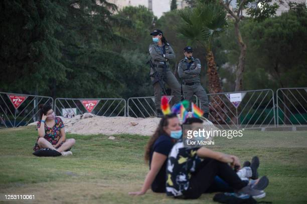 Israeli police officers stand guard during a rally in support of the LGBT community on June 28, 2020 in Jerusalem, Israel. The rally took place in...