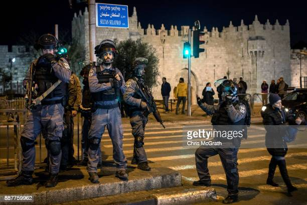 Israeli Police officers stand watch outside the Damascus Gate in the Old City on December 7 2017 in Jerusalem Israel Tension is high in Jerusalem a...