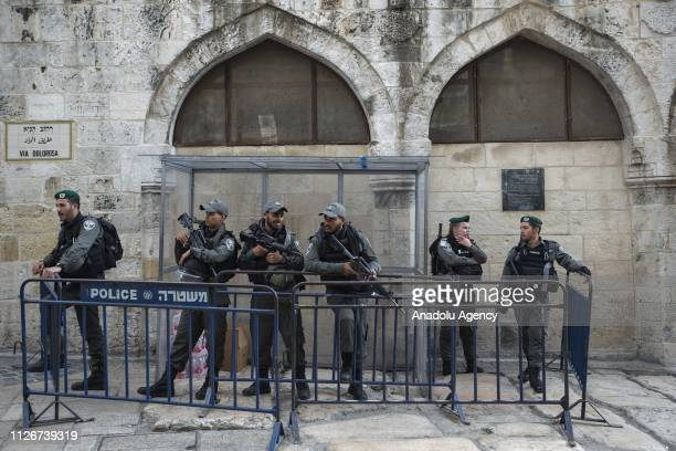 Israeli police officers take security measures as Palestinians perform Friday prayer inside the AlRahma Gate at AlAqsa Mosque Compound after the...