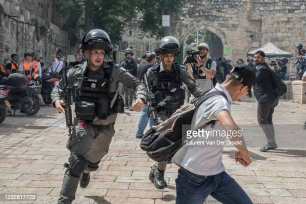 Israeli police run after a Palestinian demonstrator at the Al-Aqsa Mosque during Israel's 'Jerusalem Day' on May 10, 2021 in Jerusalem, Israel. The...
