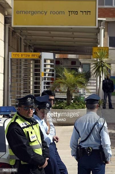 Israeli police stand guard at the entrance of the emergency ward at the Hadassah hospital on the outskirts of Jerusalem 11 February 2006 where...