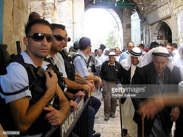 CONTENT] Israeli police survey Palestinians as they leave the Haram Al Sharif after Friday prayers
