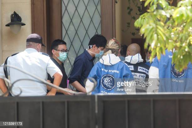 Israeli police workers enter the house of China's Ambassador to Israel Du Wei, after he was found dead in his home on May 17, 2020 in Herzliya,...
