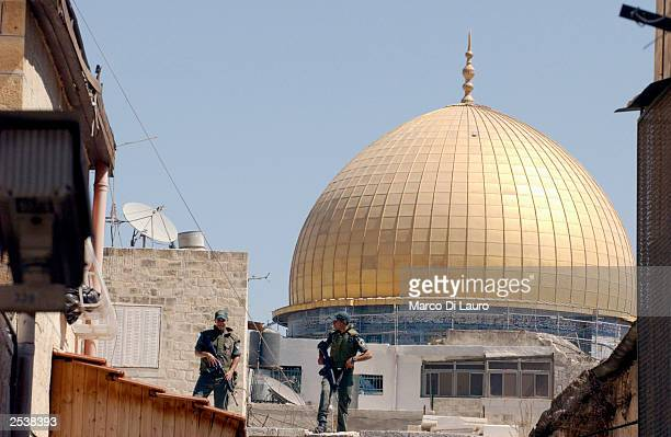 Israeli policeman stand guard on the roof of the AlAqsa Mosque the holy shrine in Jerusalem's Old City before noon prayer September 26 2003 in...