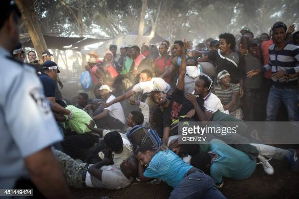 Israeli policemen and immigration officers arrest African asylum seekers after spending the last two days protesting in an outdoor camp near Nitzana...