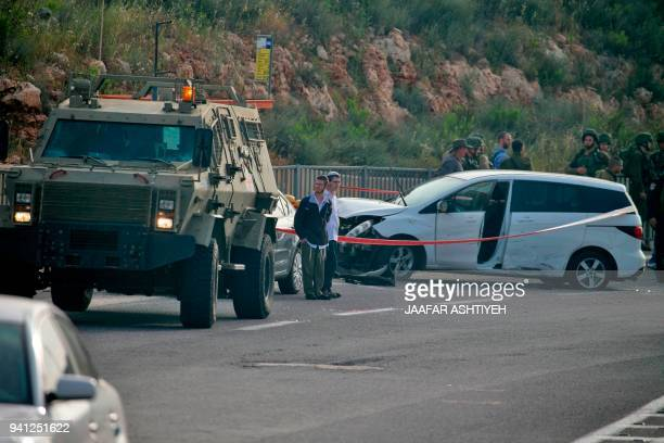 Israeli policemen cordon off the site where an Arab Israeli man was shot dead by soldiers after crashing into a hitchhiking stop near the Jewish...