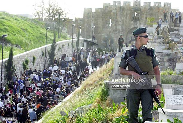 Israeli policemen provide security for thousands of Christian Pilgrims in Jerusalem celebrating Palm Sunday March 24 2002 by retracing the steps of...