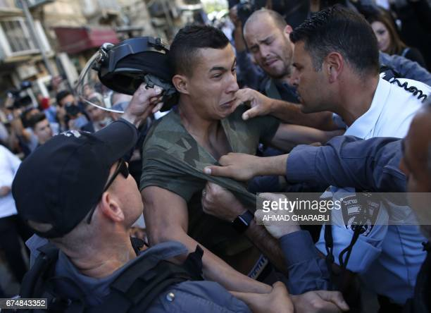 TOPSHOT Israeli policemen scuffle with a Palestinian man in Jerusalem's Old City on April 29 2017 during a protest in support of Palestinians...