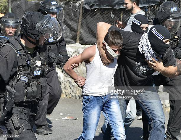 Israeli polices including secret polices disguised as a Palestinian take a Palestinian under custody after Palestinians performed Friday Prayer at...