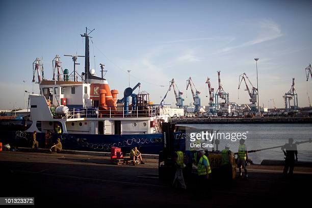 Israeli port workers unload humanitarian Aid from one of the Peace Flotilla ships at the Ashdod Port on June 1 2010 in Ashdod Israel 10 activists...