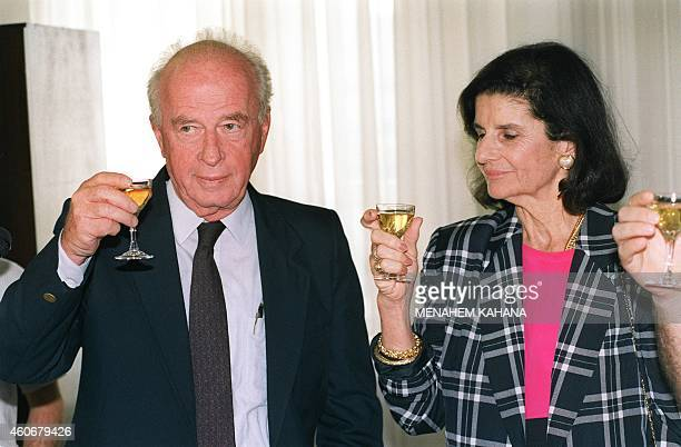 Israeli Premier Yitzhak Rabin and his wife Lea share a toast 23 September 1992 in Jerusalem with the employees of the Prime Minister's office for the...