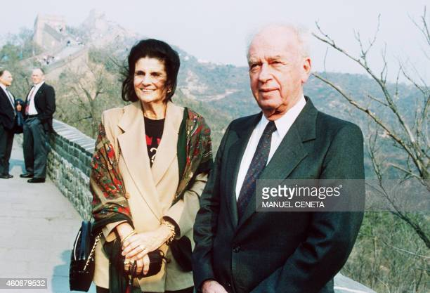 Israeli Premier Yitzhak Rabin and his wife Lea take a break after steep climb at the Great Wall 11 October 1993 in Badaling Lea Rabin died 12...