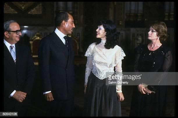 Israeli Pres Yitzhak Navon Egyptian Pres Anwar Sadat Navon's wife Ophira Sadat's wife Jihan in receiving line for state dinner at Abdin Palace