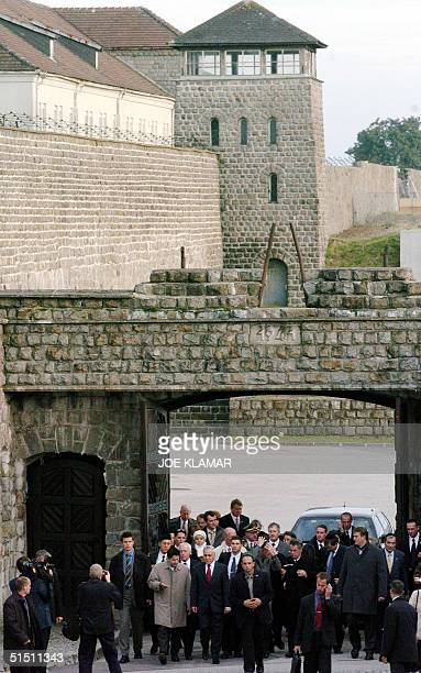 Israeli President Moshe Katsav his wife Gila and his Austrian counterpart Heinz Fischer enter the Mauthausen concentration camp built by the Nazis...