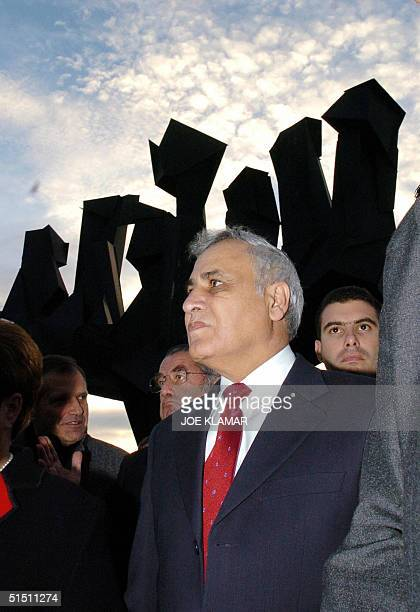 Israeli President Moshe Katsav stands in front of the monument of the victims of the Holocaust as he takes a tour around Mauthausen concentration...